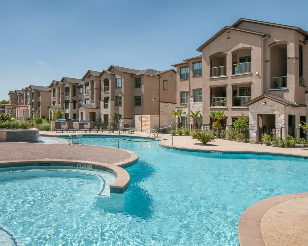 Resort-style swimming pool at Carrington Oaks in Buda, Texas