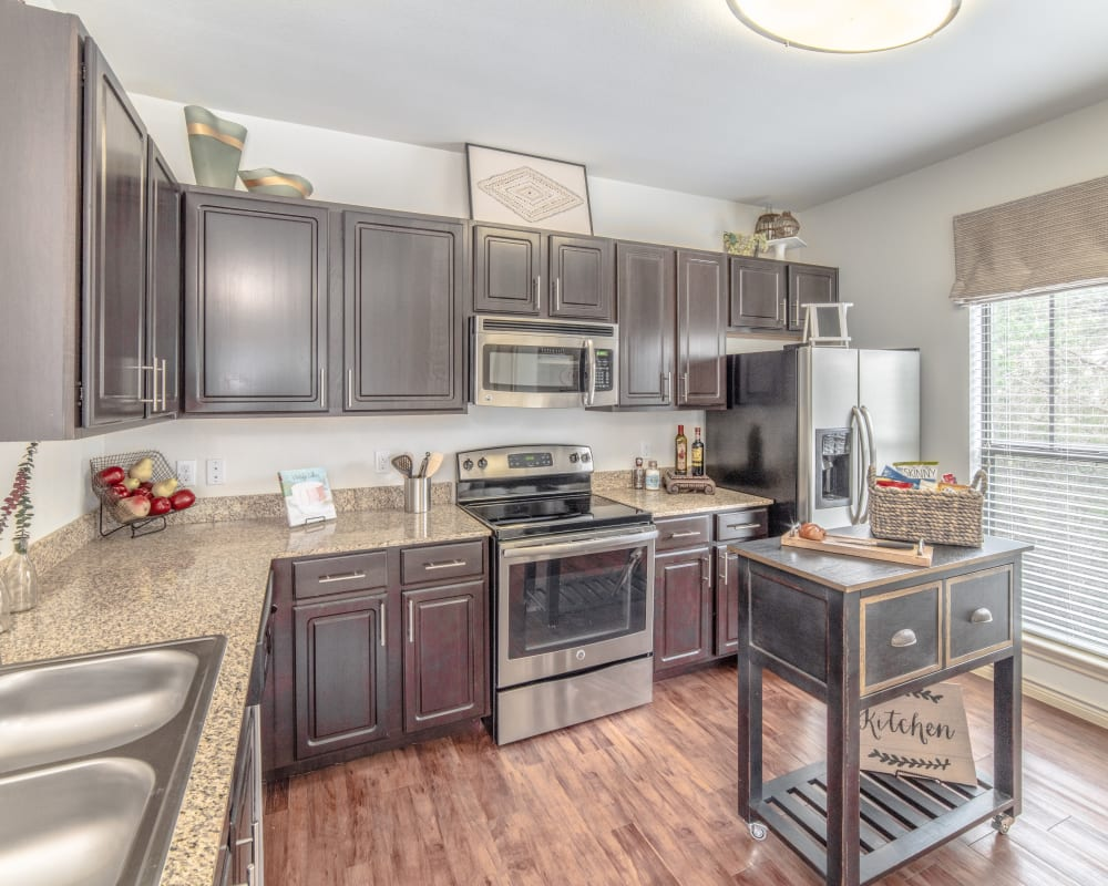 Kitchen in model home at Ethos Apartments in Austin, Texas