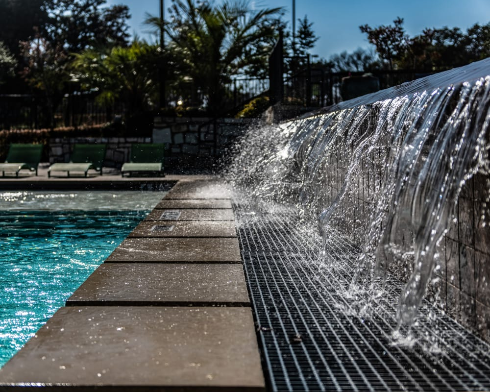 Water feature next to pool at Ethos Apartments in Austin, Texas
