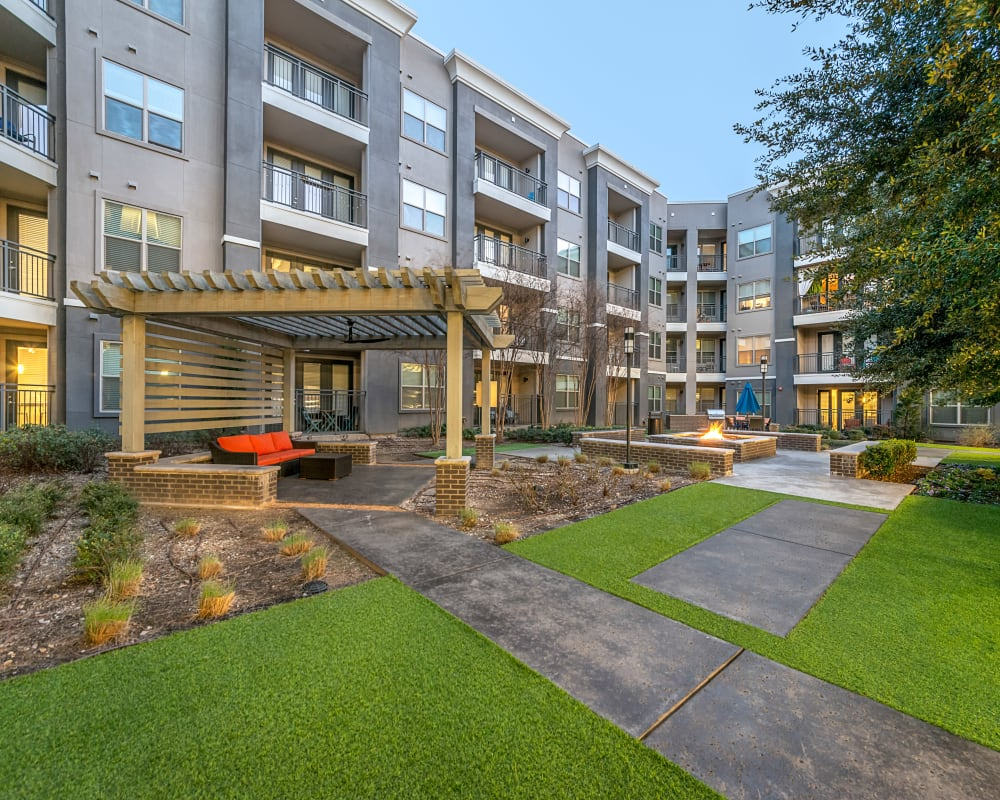Walkways and patio seating around Axis at Wycliff in Dallas, Texas