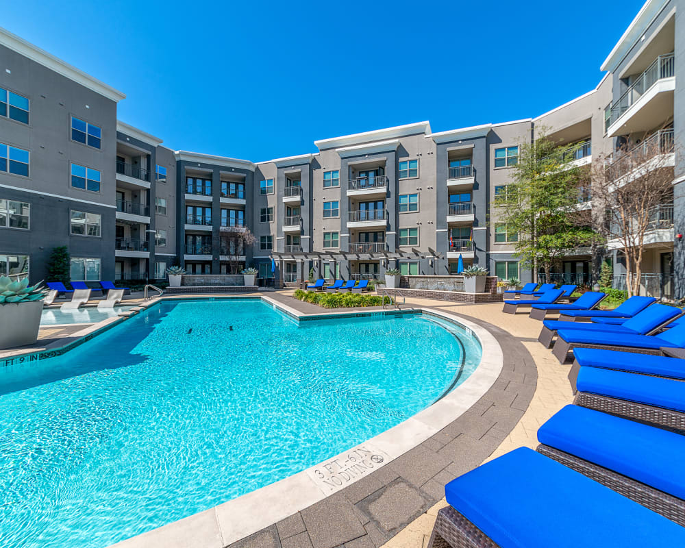 Swimming pool and lounge chairs at Axis at Wycliff in Dallas, Texas
