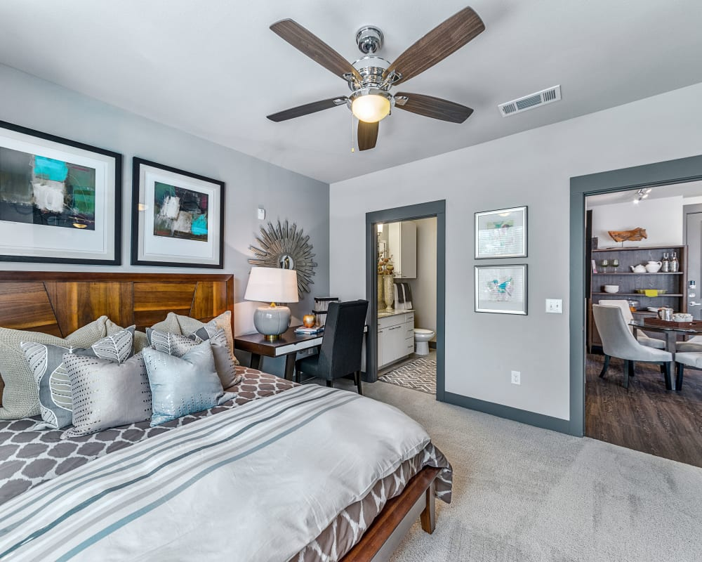 Master bedroom with ceiling fan in Dallas, Texas at Axis at Wycliff