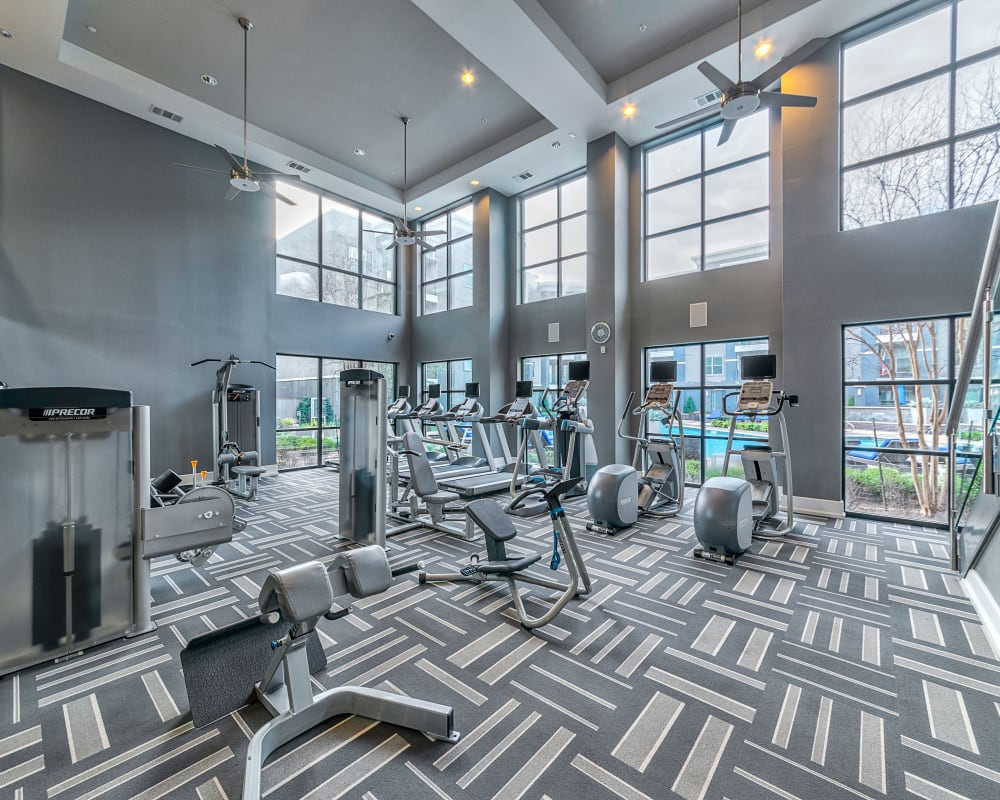 The fitness center at Axis at Wycliff in Dallas, Texas