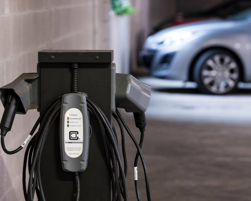 Electric car charging station at Axis 110 in Richardson,  Texas