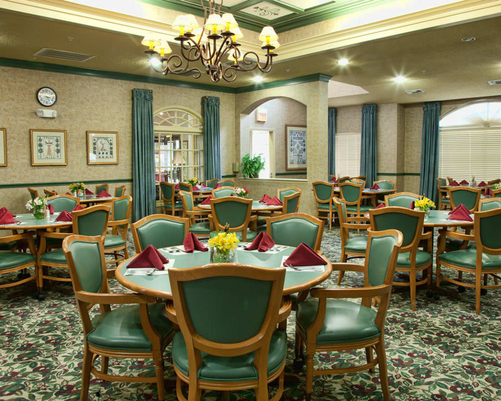 Carpeted dining hall at Carriage Inn Katy in Katy, Texas
