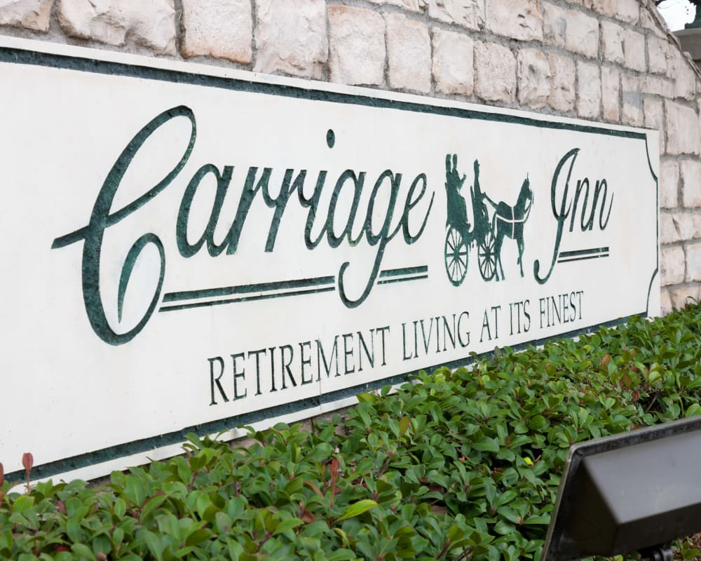 Signage for Carriage Inn Katy in Katy, Texas