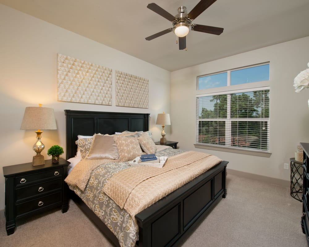 Bedroom with black accents at Vargos on the Lake in Houston, Texas