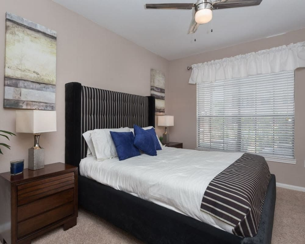 Model bedroom with blue accents at Greenbriar Park in Houston, Texas