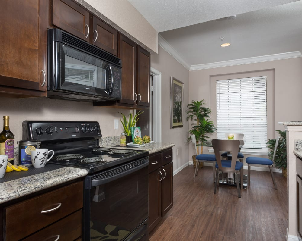Model kitchen with black appliances at Greenbriar Park in Houston, Texas