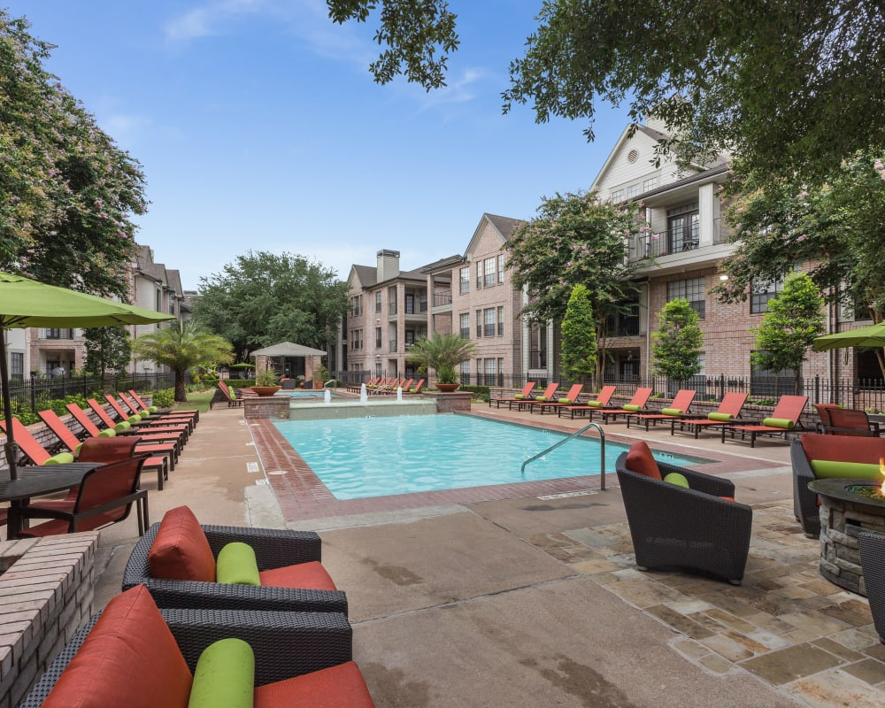 Patio seating by the pool at Greenbriar Park in Houston, Texas
