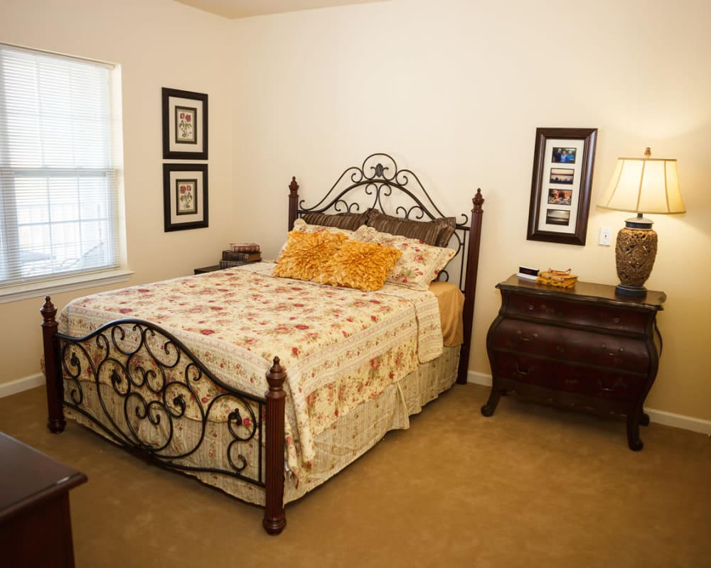 A decorated bedroom at Harmony at Falls Run in Fredericksburg, Virginia