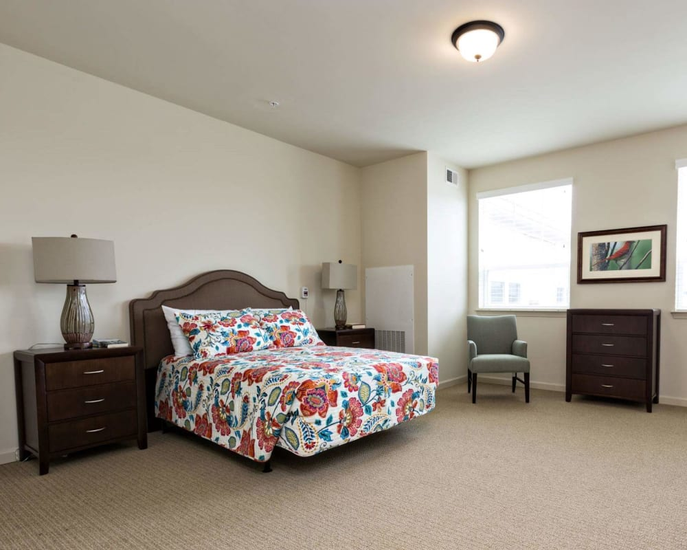 A decorated, spacious bedroom at The Harmony Collection at Hanover in Mechanicsville, Virginia