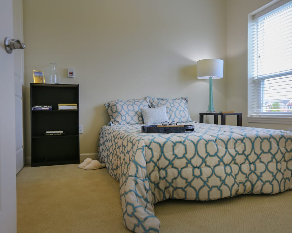 A decorated bedroom at Harmony at Spring Hill in Lorton, Virginia