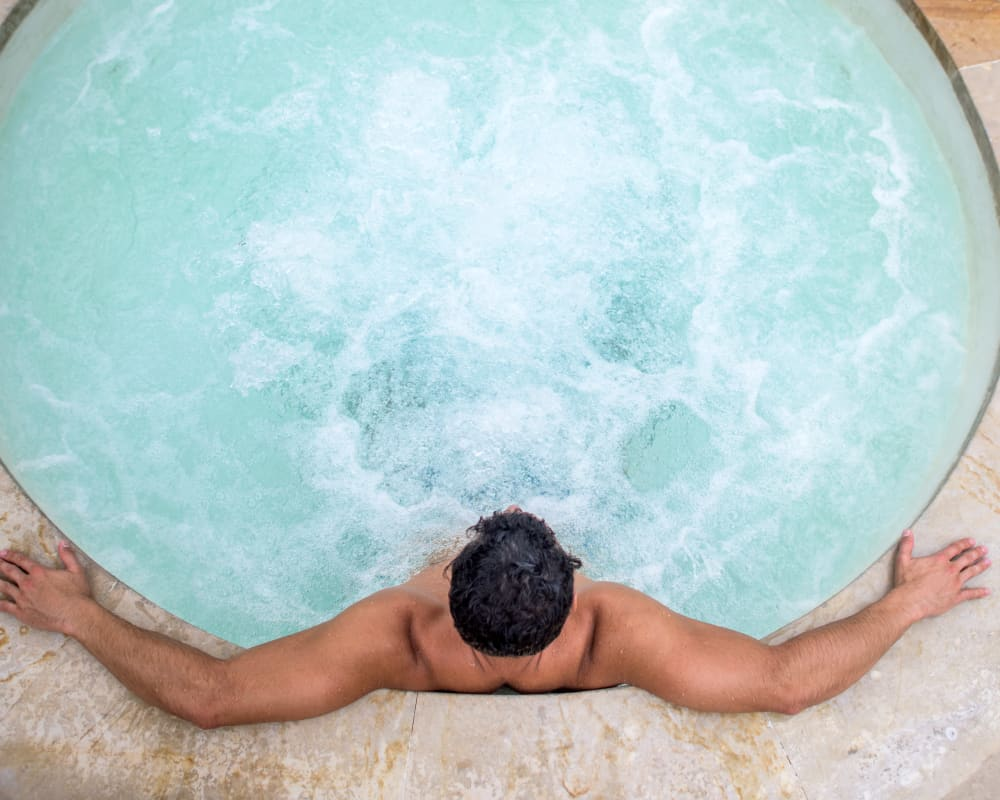Resident enjoying Cypress Pointe Apartments' hot tub in Gilroy, California