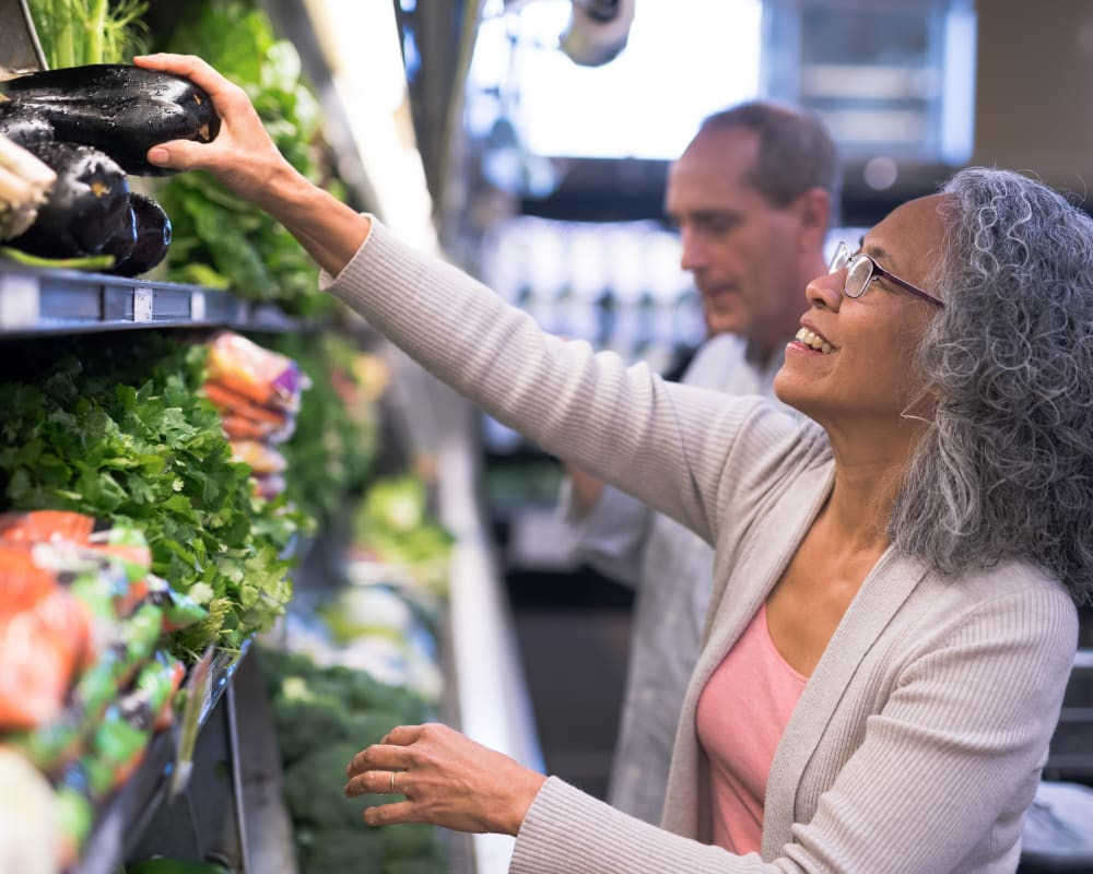 Resident shopping for produce at Village Green Apartments in Cupertino, California