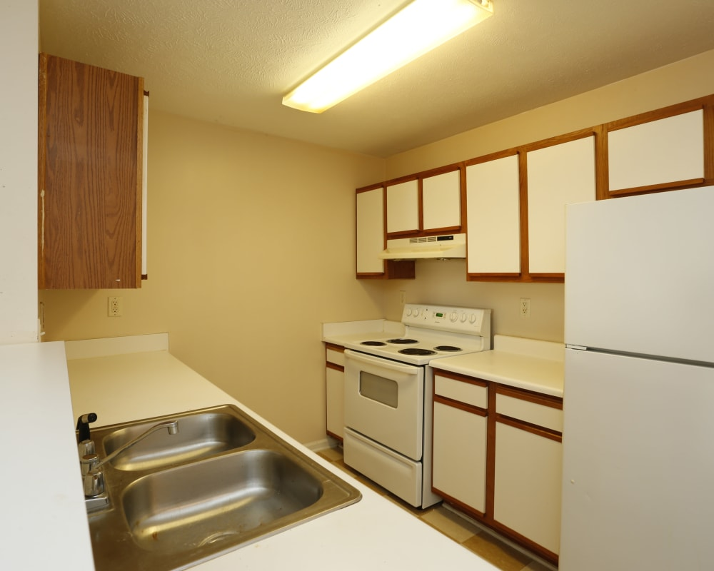 Lots of kitchen cabinet space at Ashton Park Apartments in Gulfport, Mississippi