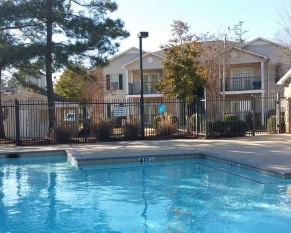 Residents can relax in the pool at Bristol Park Apartments in Jackson, Mississippi