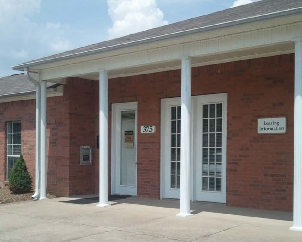 The main entrance to the leasing office at Orchard Park Apartments in Clarksville, Tennessee