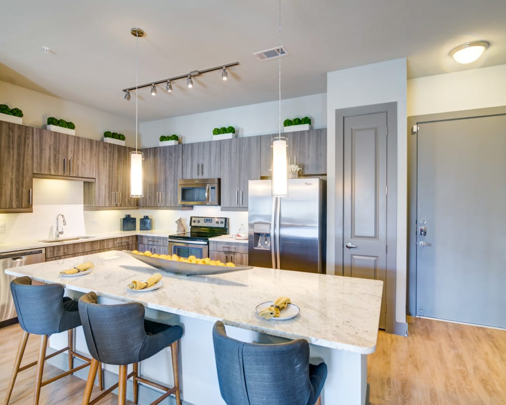 A modern apartment kitchen at The Abbey at Northpoint in Spring, Texas
