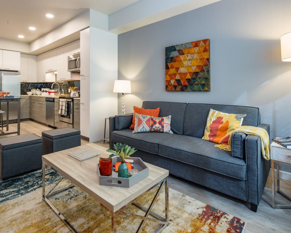 Soaring ceilings and beautiful hardwood flooring in a luxury model home's living area at EVIVA Midtown in Sacramento, California