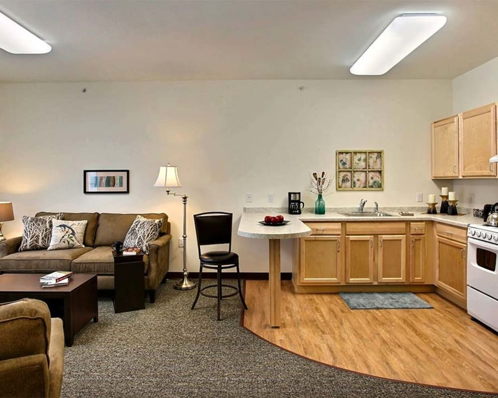 Resident apartment with a kitchen at Milestone Senior Living in Woodruff, Wisconsin.