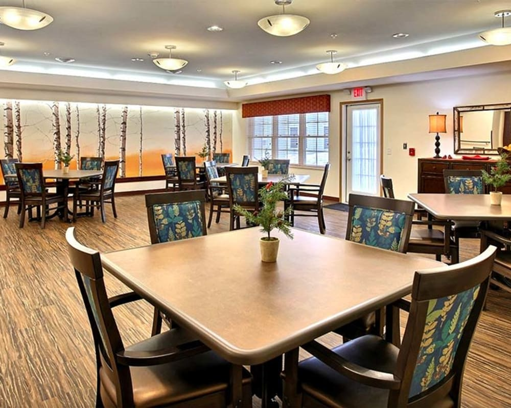Large resident dining room at Milestone Senior Living in Woodruff, Wisconsin.