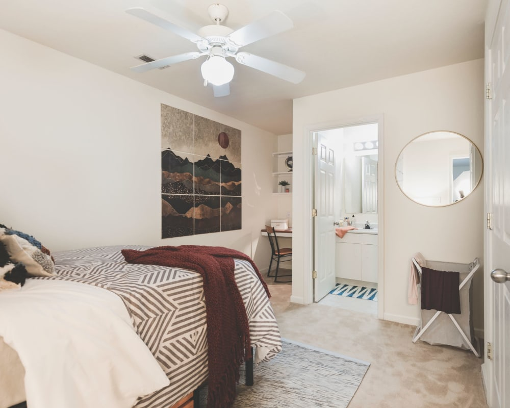 Spacious master bedroom with plush carpeting at Sunchase Apartments in Greenville, North Carolina
