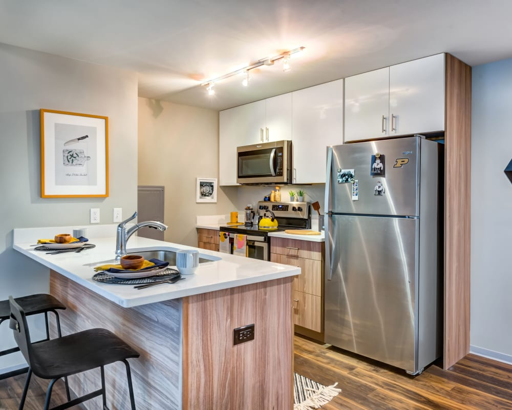 Bright, fully equipped kitchen at RISE on Chauncey in West Lafayette, Indiana
