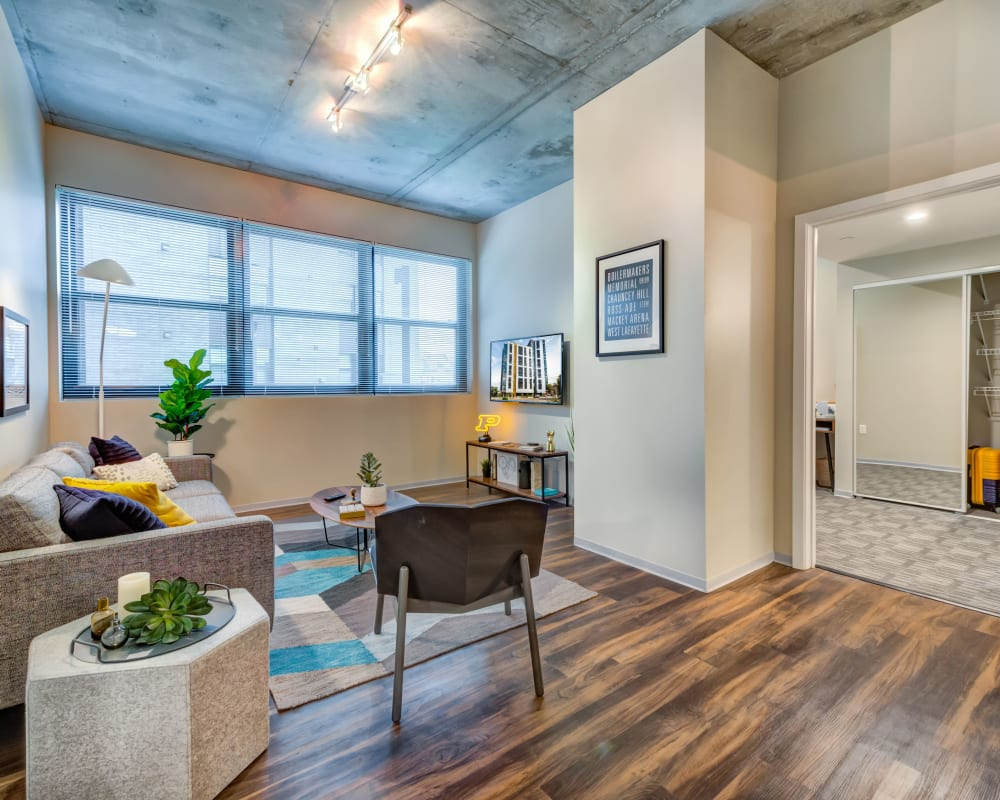 Spacious, bright living room at RISE on Chauncey in West Lafayette, Indiana