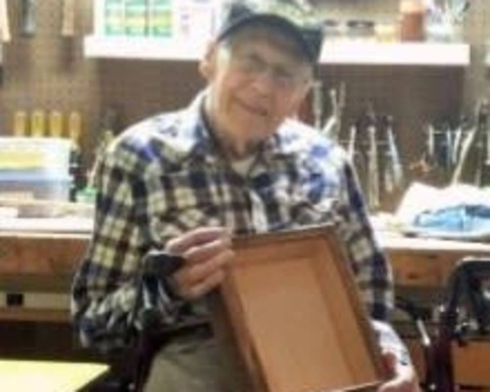 Resident Harold making memory boxes for his dare to dream event at Milestone Senior Living in Eagle River, Wisconsin.