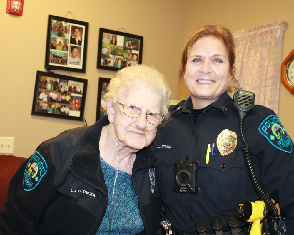 Resident Georgie with local police for her dare to dream event from Milestone Senior Living in Faribault, Minnesota.