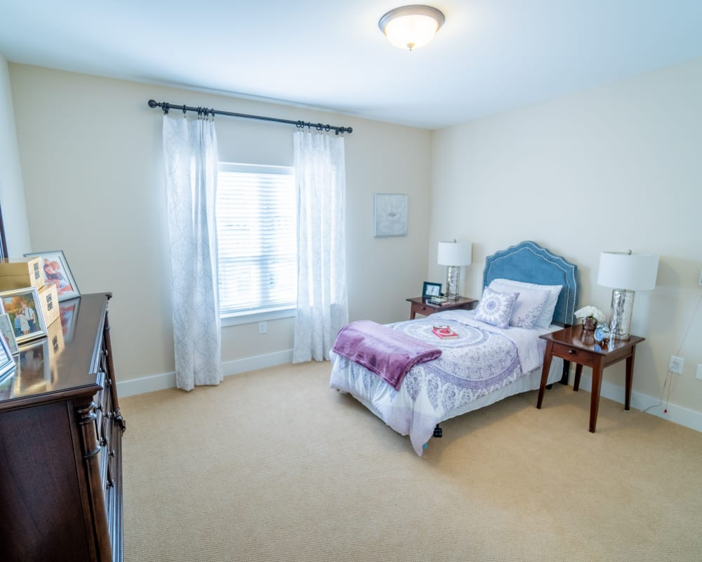 A decorated bedroom at Harmony at Avon in Avon, Indiana