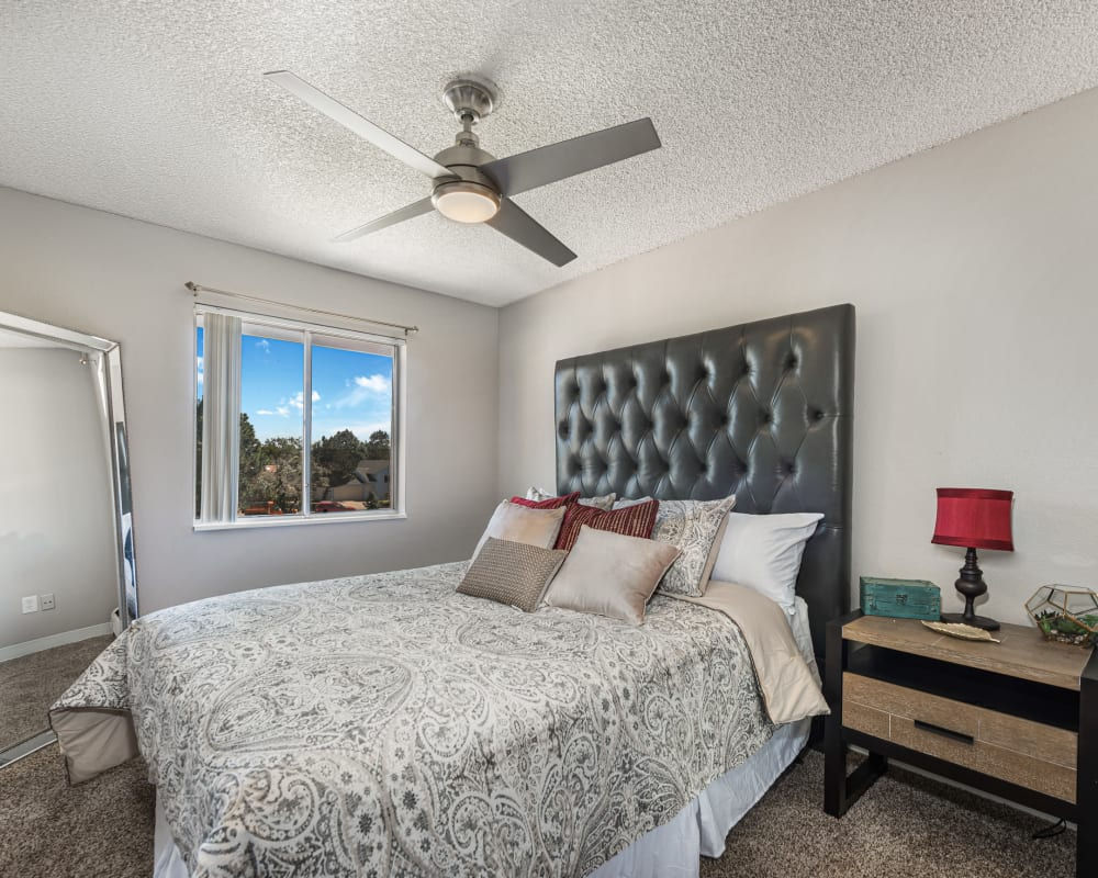 Well-lit bedroom at Florida Station Apartments in Aurora, Colorado