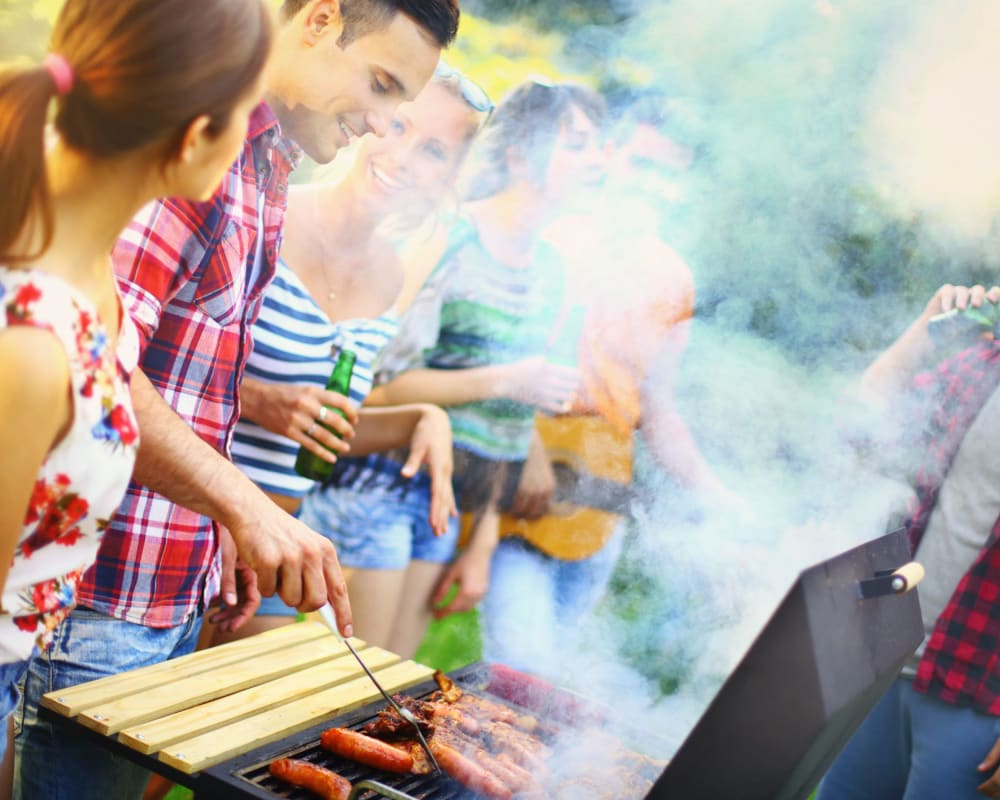 Residents grilling food at Crestone Apartments in Brighton, Colorado