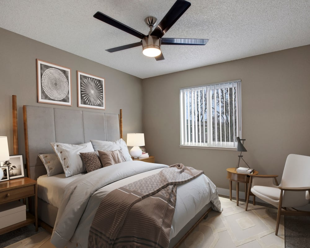 Bedroom with large window in model home at The Hawthorne in Carmichael, California