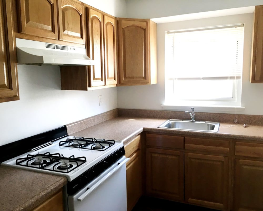 Kitchen with large window at Suburban Terrace in Hackensack, New Jersey