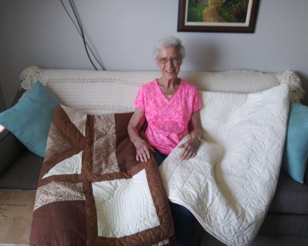 A resident displaying the quilts she made at Arlington Place of Red Oak in Red Oak, Iowa.