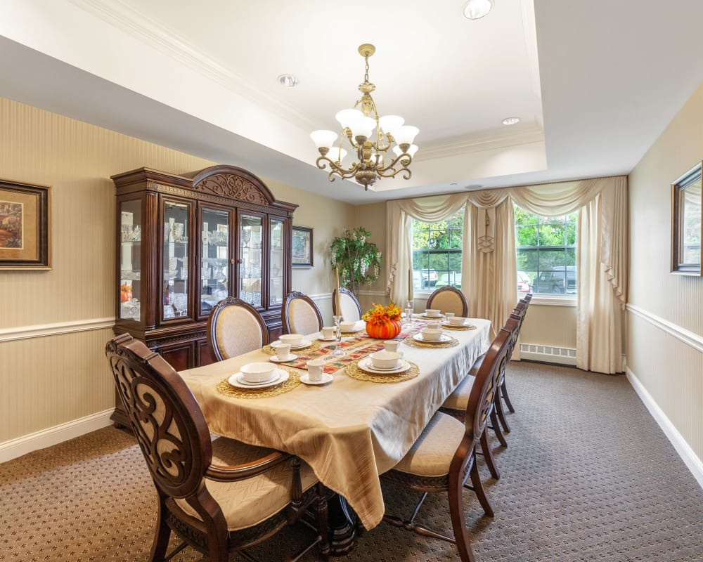 Private family dining room with a large table with a white tablecloth at The Hearth at Tudor Gardens in Zionsville, Indiana