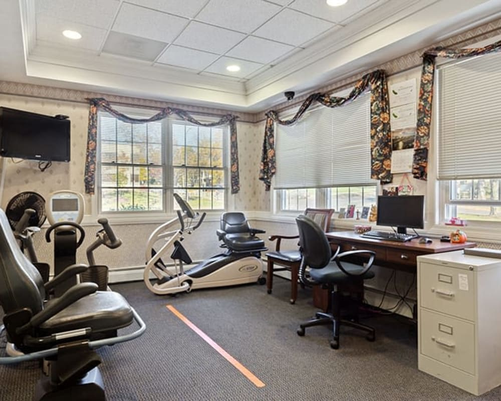 Activity room with seated elliptical machines and a computer for residents at The Hearth on James in Syracuse, New York