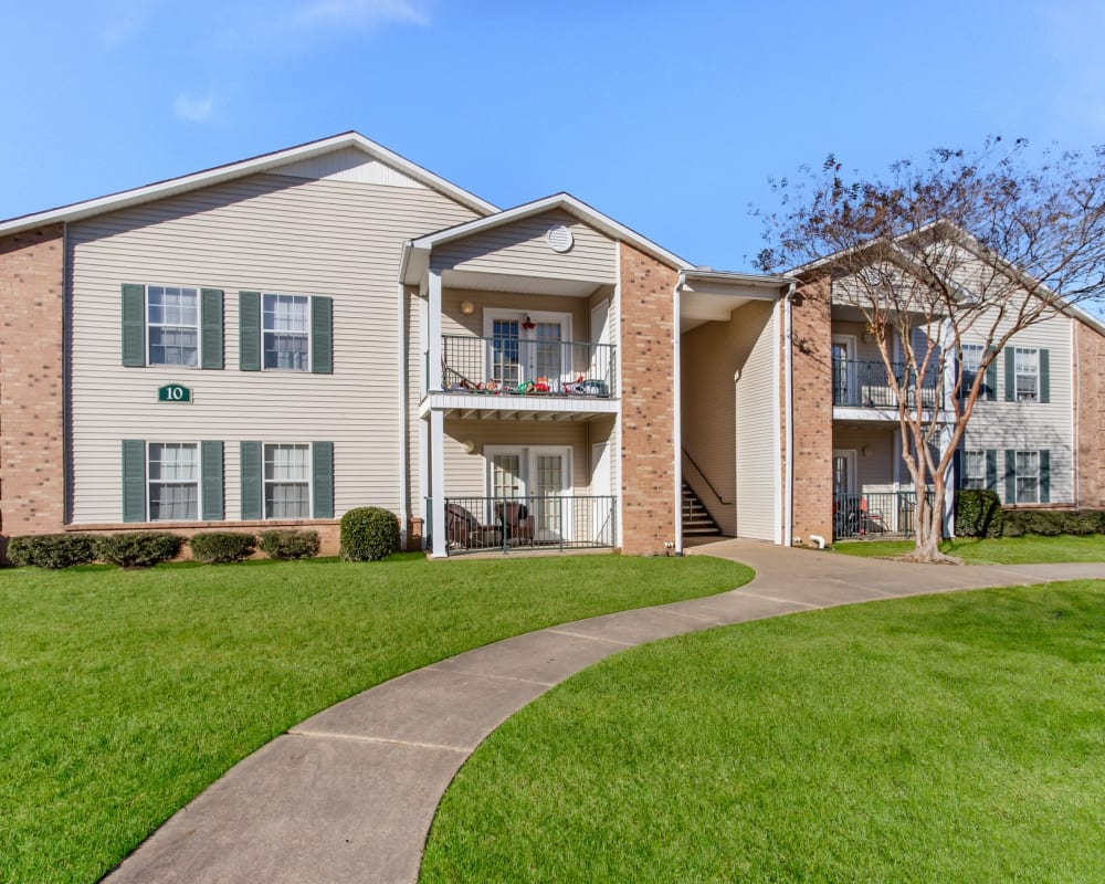 Comfortable seating and an open kitchen in the clubhouse at Bristol Park Apartments in Jackson, Mississippi