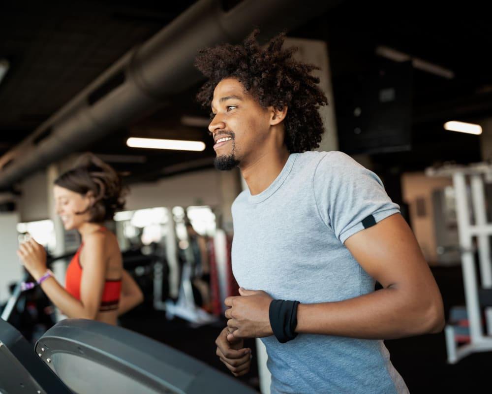 Resident running on a treadmill at Lofts at Cargill Falls Mill in Putnam, Connecticut