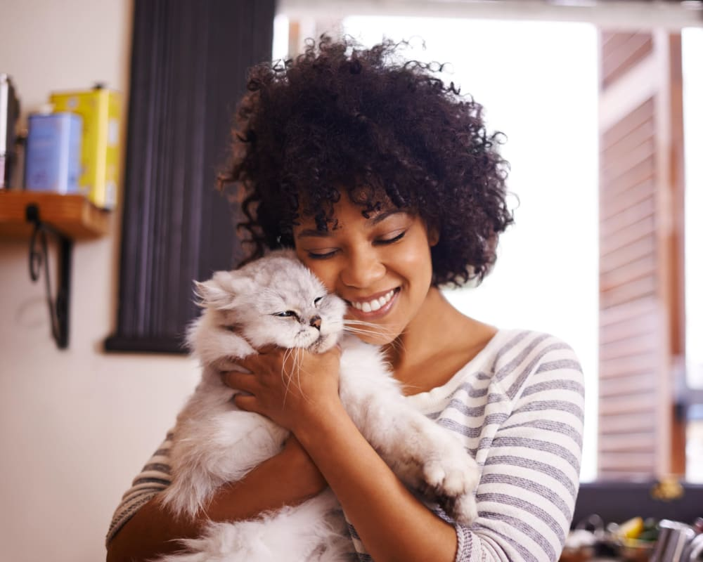 Resident hugging her cat at St. Charles Square Apartments in Carol Stream, Illinois