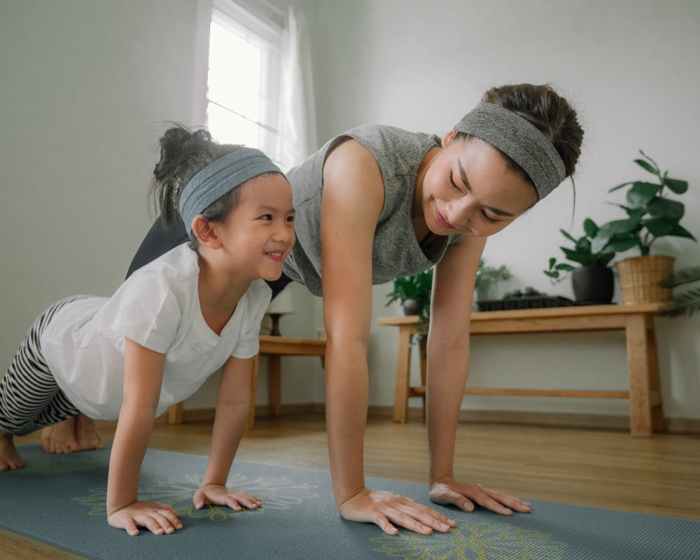 Rsident and her daughter doing yoga at Glen Hollow Apartments in Croydon, Pennsylvania