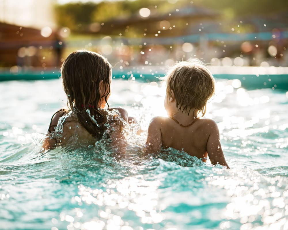 Kids swimming in the pool at Glen Hollow Apartments in Croydon, Pennsylvania