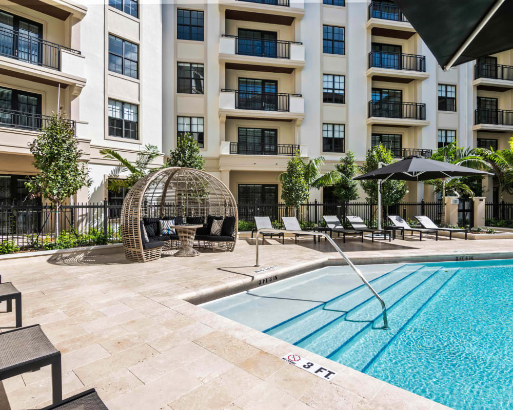 View of the entire pool area with all the extra amenities at 6600 Main in Miami Lakes, Florida