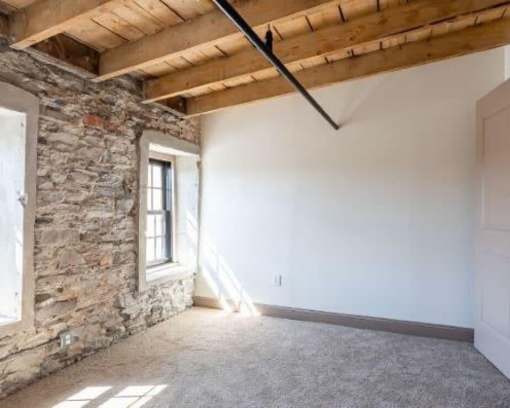 Bedroom at Lofts at Cargill Falls Mill in Putnam, Connecticut