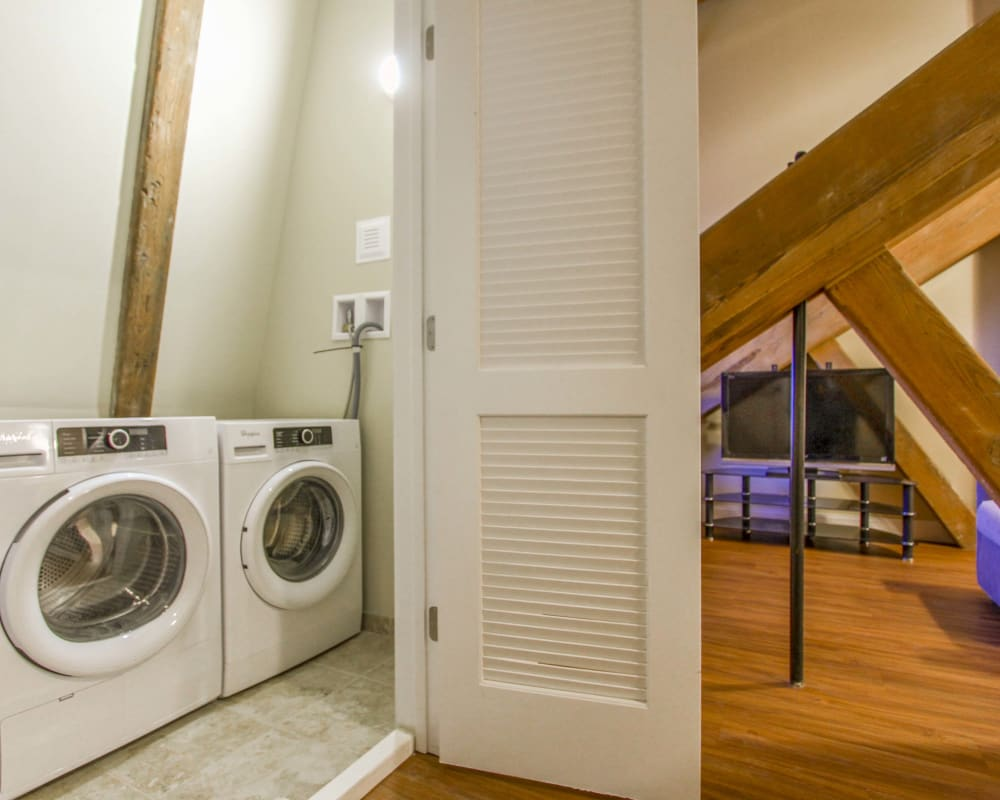 Apartment with in-home washer and dryer at The Lofts at Ponemah Mills in Taftville, Connecticut