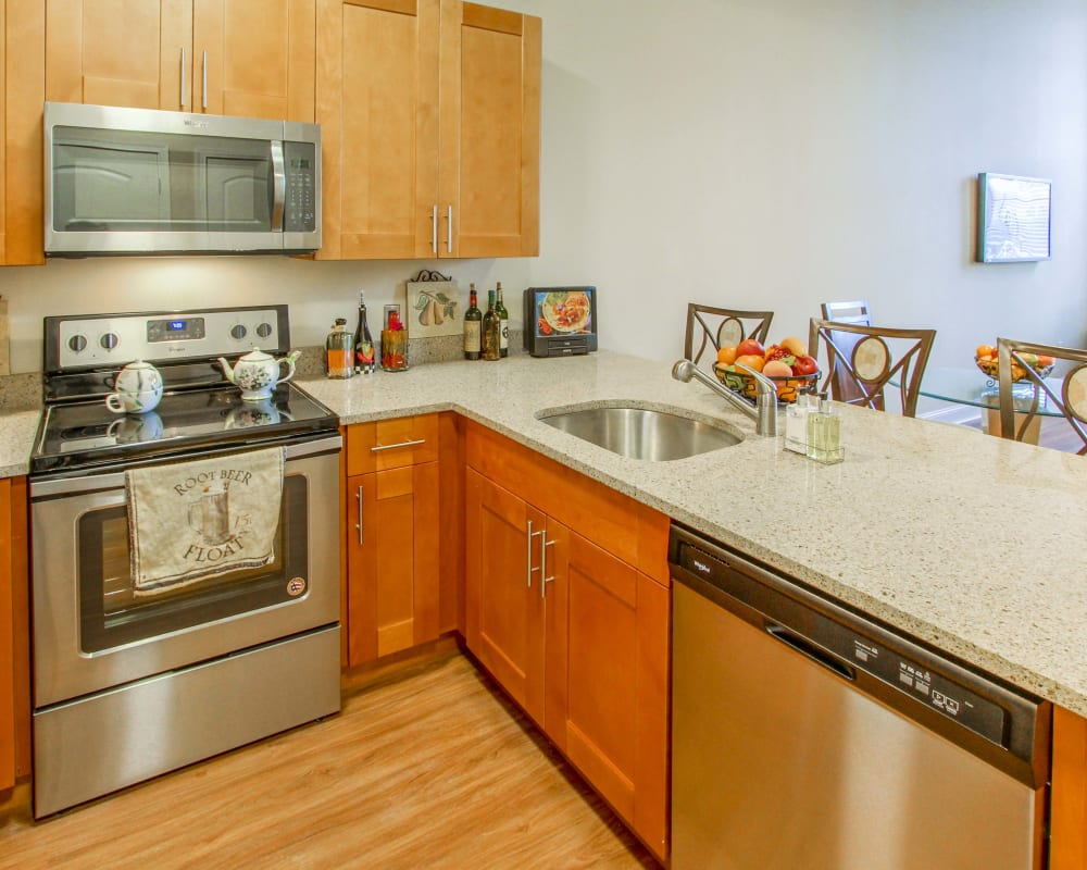 Kitchen with stainless steel appliances at The Lofts at Ponemah Mills in Taftville, Connecticut