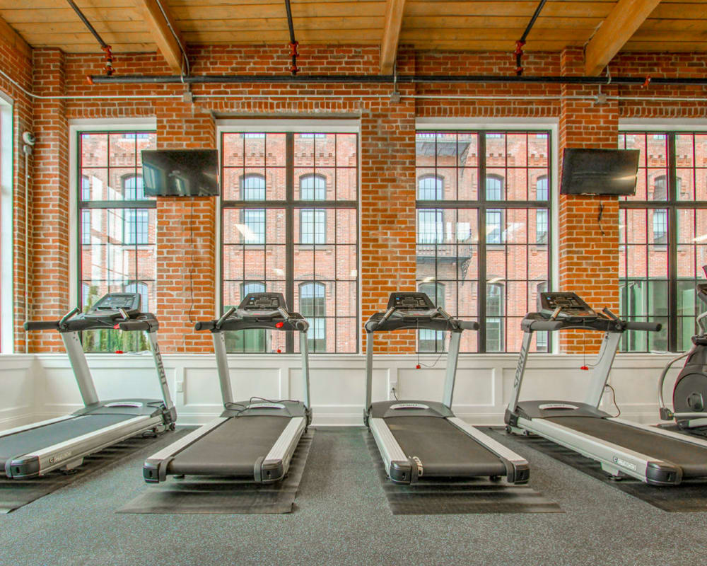 Fitness center with treadmills at The Lofts at Ponemah Mills in Taftville, Connecticut