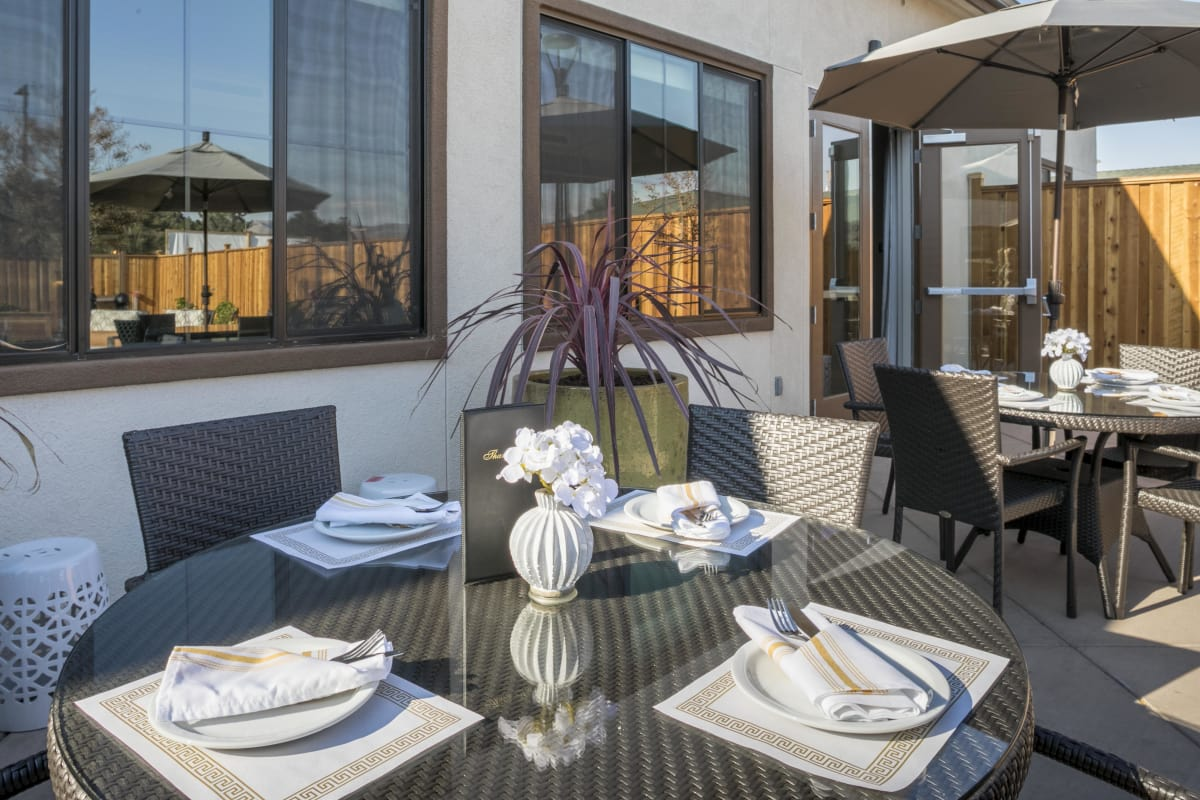 Beautiful outdoor dining tables at The Oaks at Nipomo in Nipomo, California
